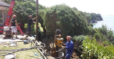 Drilling And Installation Of Timber Poles For Retaining Wall