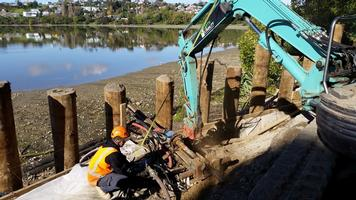 Drilling Of Tie Back Anchors For Timber Pole Retaining Wall