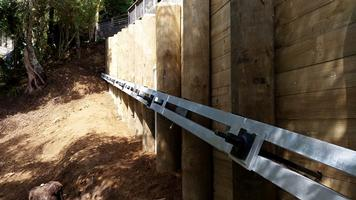 back Timber Pole Retaing Wall With Steel Waler And Anchors