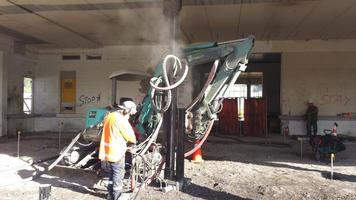 Drilling And Installing Micropiles With Permanent Casing Inside Existing Building