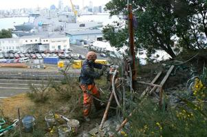 Installation Of Micropiles At Top Of Cliffline For Draped Rockfall Netting System